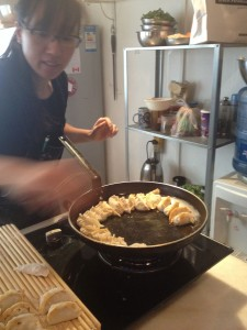 Michelle fills the pan at Black Sesame Kitchen
