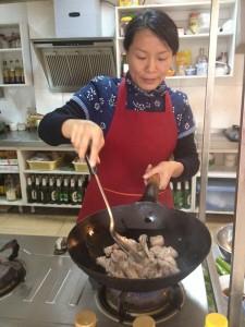 Chun Yi preparing duck legs at Hutong Cuisine