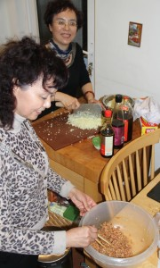 First and Second Aunties make the filling