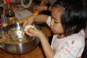 Xuan Xuan wrapping dumplings