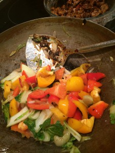 Stir-frying the peppers